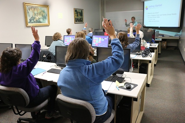 body_classroom_raising_hands